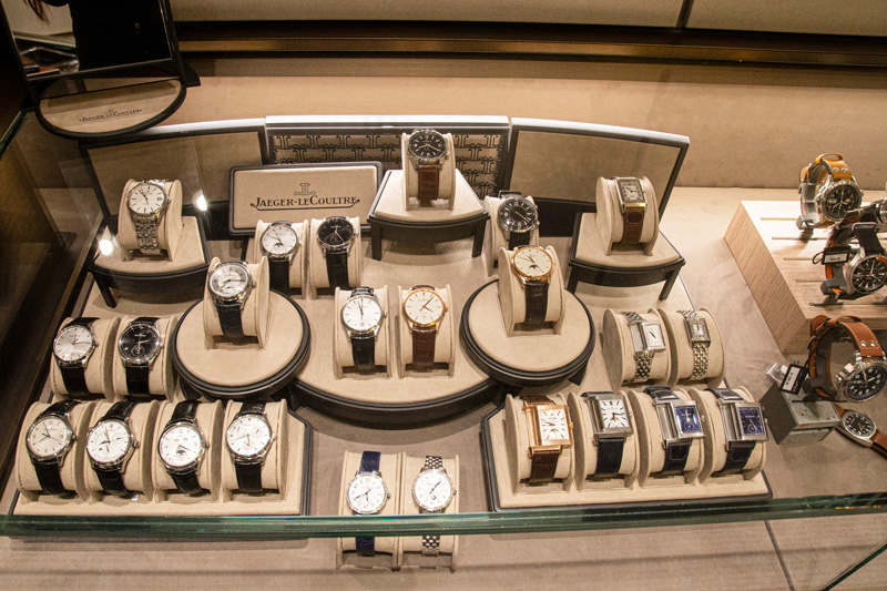 A display case in the watch salon showcasing an array of Jaeger LeCoultre timepieces.