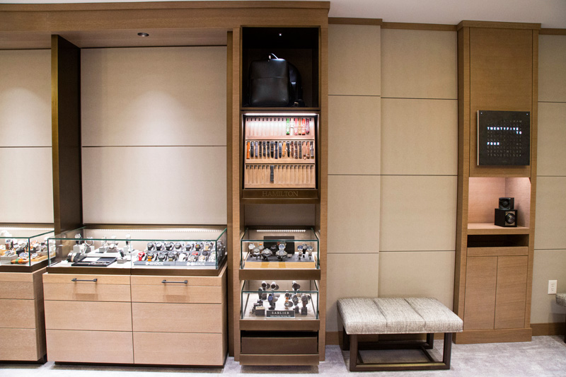 A showcase wall for luxury watches and accessories in the Watch Salon.