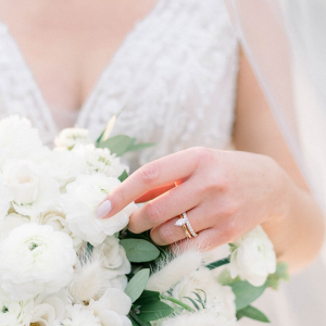 Bride holding flowers with gold band diamond ring
